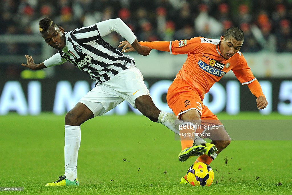 <a gi-track='captionPersonalityLinkClicked' href=/galleries/search?phrase=Paul+Pogba&family=editorial&specificpeople=5805302 ng-click='$event.stopPropagation()'>Paul Pogba</a> (L) of Juventus competes with Allan Marques of Udinese Calcio during the Serie A match between Juventus and Udinese Calcio at Juventus Arena on December 1, 2013 in Turin, Italy.