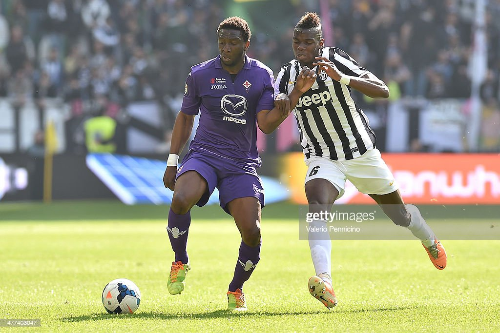<a gi-track='captionPersonalityLinkClicked' href=/galleries/search?phrase=Paul+Pogba&family=editorial&specificpeople=5805302 ng-click='$event.stopPropagation()'>Paul Pogba</a> (R) of Juventus competes with Anderson of ACF Fiorentina during the Serie A match between Juventus and ACF Fiorentina at Juventus Arena on March 9, 2014 in Turin, Italy.