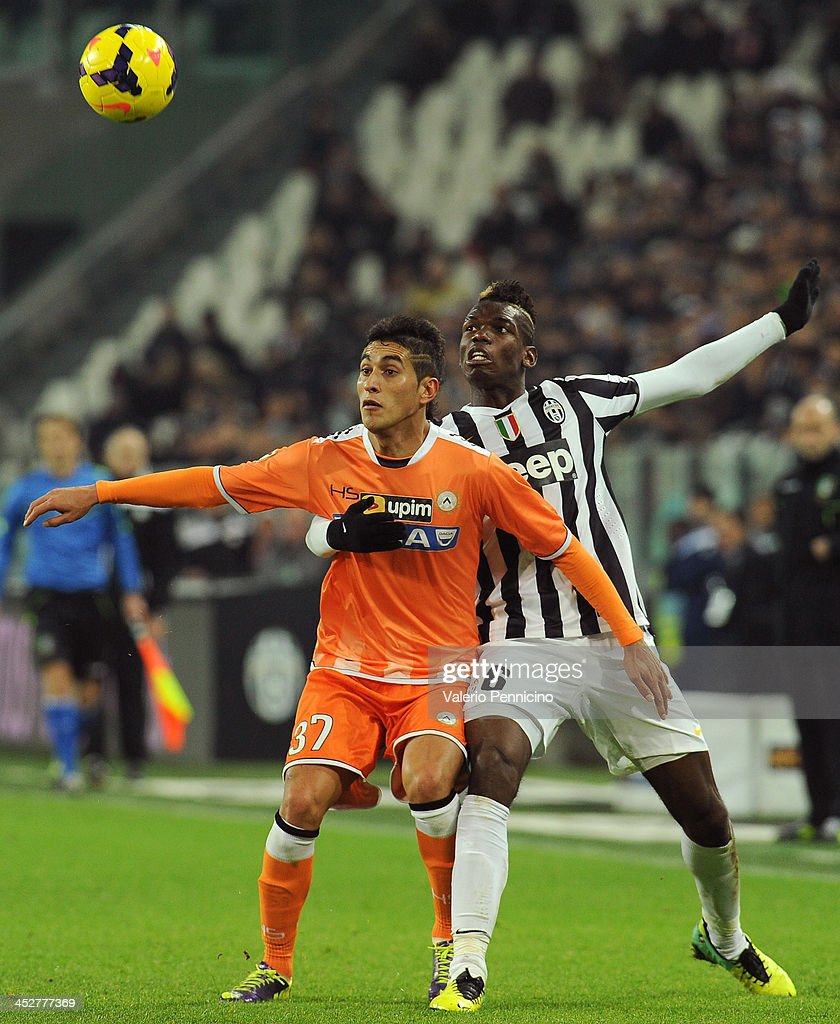 <a gi-track='captionPersonalityLinkClicked' href=/galleries/search?phrase=Paul+Pogba&family=editorial&specificpeople=5805302 ng-click='$event.stopPropagation()'>Paul Pogba</a> (R) of Juventus competes with Roberto Pereyra of Udinese Calcio during the Serie A match between Juventus and Udinese Calcio at Juventus Arena on December 1, 2013 in Turin, Italy.
