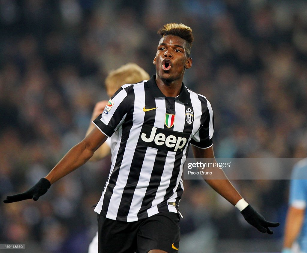 Paul Pogba of Juventus FC celebrates after scoring the opening goal during the Serie A match between SS Lazio and Juventus FC at Stadio Olimpico on November 22, 2014 in Rome, Italy.