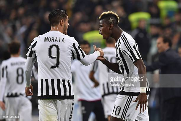 Paul Pogba of Juventus FC celebrates after scoring the opening goal with team mate Alvaro Morata during the Serie A match between Juventus FC and...
