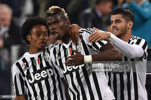 Paul Pogba of Juventus FC celebrates after scoring the opening goal with team mates Juan Cuadrado and Alvaro Morata during the Serie A match between...