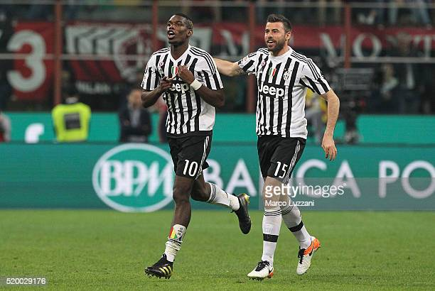Paul Pogba of Juventus FC celebrates his goal with his teammate Andrea Barzagli during the Serie A match between AC Milan and Juventus FC at Stadio...