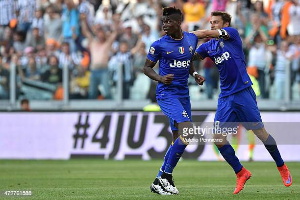 Paul Pogba of Juventus FC celebrates the opening goal with team mate Claudio Marchisio during the Serie A match between Juventus FC and Cagliari...