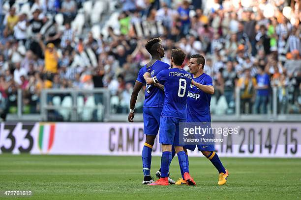 Paul Pogba of Juventus FC celebrates the opening goal with team mates Claudio Marchisio and Simone Padoin during the Serie A match between Juventus...