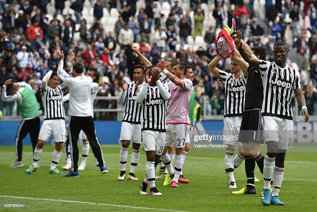 <a gi-track='captionPersonalityLinkClicked' href=/galleries/search?phrase=Paul+Pogba&family=editorial&specificpeople=5805302 ng-click='$event.stopPropagation()'>Paul Pogba</a> (R) of Juventus FC celebrates victory at the end of the Serie A match between Juventus FC and Carpi FC at Juventus Arena on May 1, 2016 in Turin, Italy.