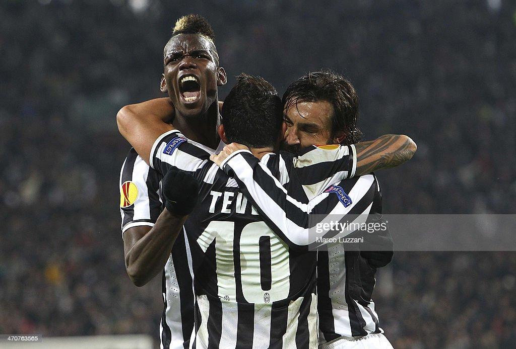 <a gi-track='captionPersonalityLinkClicked' href=/galleries/search?phrase=Paul+Pogba&family=editorial&specificpeople=5805302 ng-click='$event.stopPropagation()'>Paul Pogba</a> (L) of Juventus FC celebrates with his team-mates <a gi-track='captionPersonalityLinkClicked' href=/galleries/search?phrase=Carlos+Tevez&family=editorial&specificpeople=220555 ng-click='$event.stopPropagation()'>Carlos Tevez</a> (C) and <a gi-track='captionPersonalityLinkClicked' href=/galleries/search?phrase=Andrea+Pirlo&family=editorial&specificpeople=198835 ng-click='$event.stopPropagation()'>Andrea Pirlo</a> (R) during the UEFA Europa League Round of 32 match between Juventus and AS Trabzonspor at Juventus Arena on February 20, 2014 in Turin, Italy.