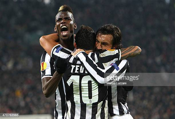 Paul Pogba of Juventus FC celebrates with his teammates Carlos Tevez and Andrea Pirlo during the UEFA Europa League Round of 32 match between...