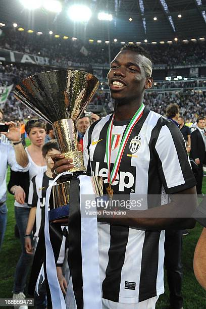 Paul Pogba of Juventus FC celebrates with the Serie A trophy at the end of the Serie A match between Juventus and Cagliari Calcio at Juventus Arena...