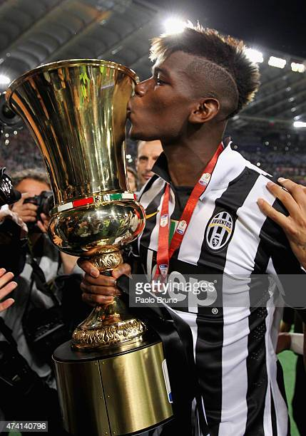 Paul Pogba of Juventus FC celebrates with the trophy after winning the TIM Cup final match against SS Lazio at Olimpico Stadium on May 20 2015 in...