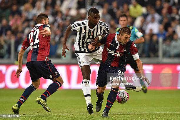 Paul Pogba of Juventus FC clashes with Daniele Gastaldello of Bologna FC during the Serie A match between Juventus FC and Bologna FC at Juventus...