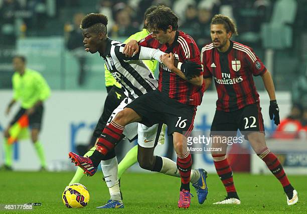 Paul Pogba of Juventus FC competes for the ball with Andrea Poli of AC Milan during the Serie A match between Juventus FC and AC Milan at Juventus...