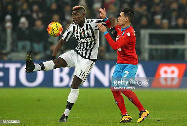 Paul Pogba of Juventus FC competes for the ball with Jose Maria Callejon of SSC Napoli during the Serie A match between and Juventus FC and SSC...