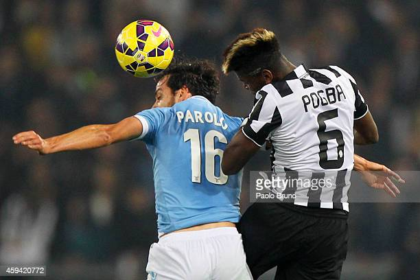 Paul Pogba of Juventus FC competes for the ball with Marco Parolo of SS Lazio during the Serie A match between SS Lazio and Juventus FC at Stadio...