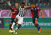 Paul Pogba of Juventus FC competes for the ball with Rolando Mandragora of Genoa CFC during the Serie A match between Genoa CFC and Juventus FC at...