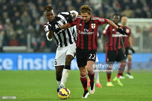 Paul Pogba of Juventus FC competes with Alessio Cerci of AC Milan during the Serie A match between Juventus FC and AC Milan at Juventus Arena on...