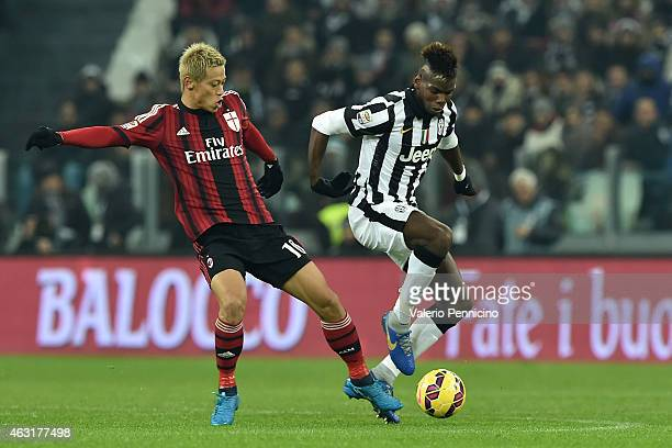 Paul Pogba of Juventus FC competes with Keisuke Honda of AC Milan during the Serie A match between Juventus FC and AC Milan at Juventus Arena on...