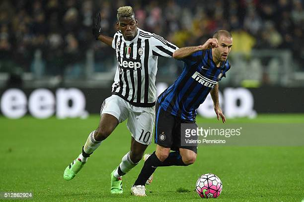 Paul Pogba of Juventus FC competes with Rodrigo Palacio of FC Internazionale Milano during the Serie A match between Juventus FC and FC...