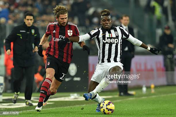 Paul Pogba of Juventus FC is challenged by Alessio Cerci of AC Milan during the Serie A match between Juventus FC and AC Milan at Juventus Arena on...