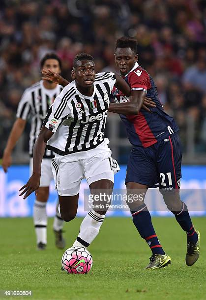 Paul Pogba of Juventus FC is challenged by Amadou Diawara of Bologna FC during the Serie A match between Juventus FC and Bologna FC at Juventus Arena...