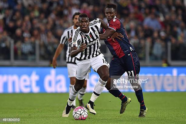 Paul Pogba of Juventus FC is challenged by AmadouÊDiawara of Bologna FC during the Serie A match between Juventus FC and Bologna FC at Juventus Arena...