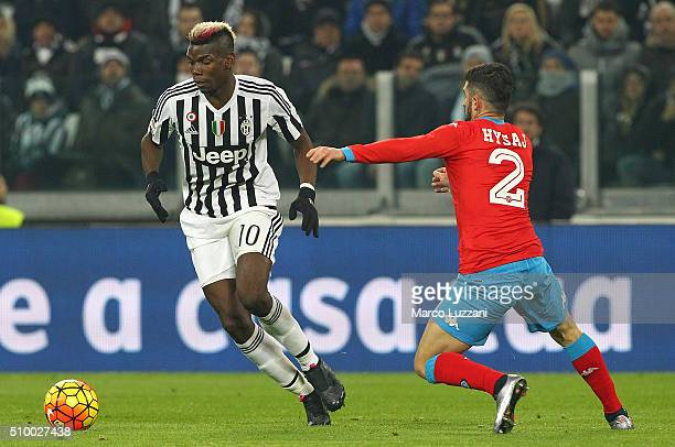 Paul Pogba of Juventus FC is challenged by Elseid Hysaj of SSC Napoli during the Serie A match between and Juventus FC and SSC Napoli at Juventus...