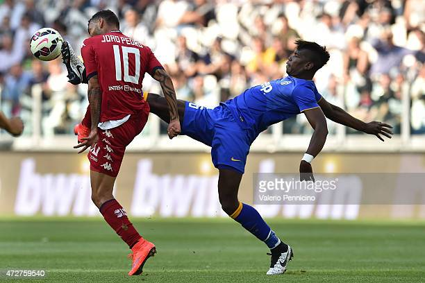 Paul Pogba of Juventus FC is challenged by Galvao of Cagliari Calcio during the Serie A match between Juventus FC and Cagliari Calcio at Juventus...