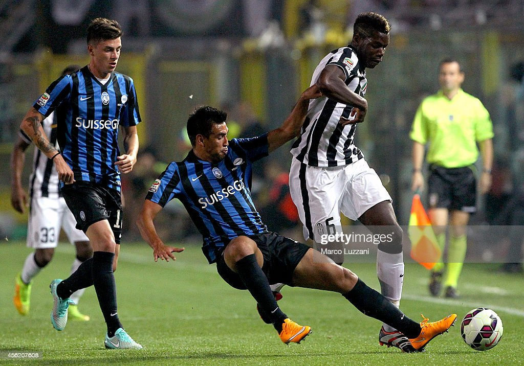 <a gi-track='captionPersonalityLinkClicked' href=/galleries/search?phrase=Paul+Pogba&family=editorial&specificpeople=5805302 ng-click='$event.stopPropagation()'>Paul Pogba</a> (R) of Juventus FC is challenged by <a gi-track='captionPersonalityLinkClicked' href=/galleries/search?phrase=Marcelo+Estigarribia&family=editorial&specificpeople=5356243 ng-click='$event.stopPropagation()'>Marcelo Estigarribia</a> (L) of Atalanta BC during the Serie A match between Atalanta BC v Juventus FC at Stadio Atleti Azzurri d'Italia on September 27, 2014 in Bergamo, Italy.