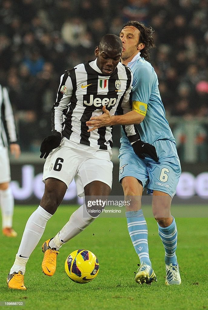 Paul Pogba (L) of Juventus FC is challenged by Stefano Mauri of S.S. Lazio during the TIM cup match between Juventus FC and S.S. Lazio at Juventus Arena on January 22, 2013 in Turin, Italy.
