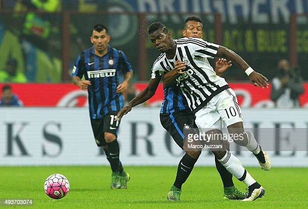 Paul Pogba of Juventus FC is challenged by with Vasquez Fredy Alejandro Guarin of FC Internazionale Milano during the Serie A match between FC...