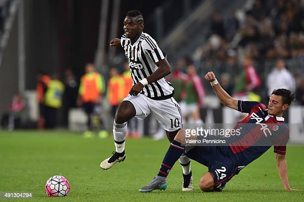 Paul Pogba of Juventus FC is tackled by AlexÊFerrari of Bologna FC during the Serie A match between Juventus FC and Bologna FC at Juventus Arena on...