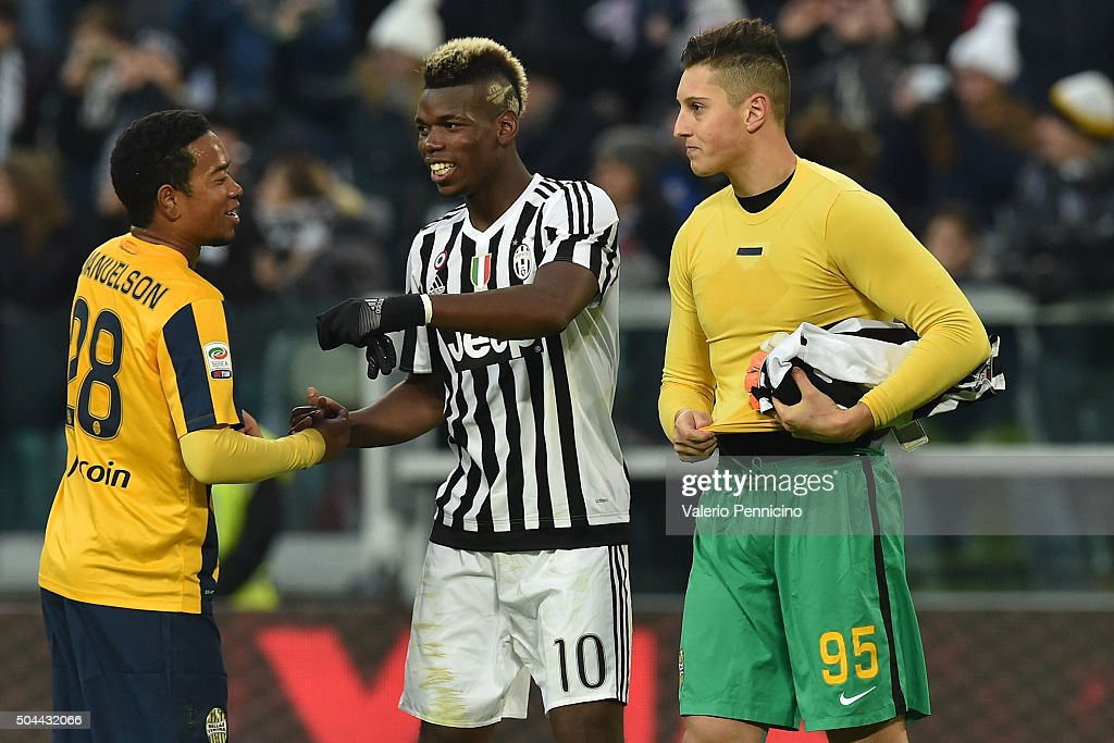 Paul Pogba (C) of Juventus FC salutes Urby Emanuelson (L) of Hellas Verona FC at the end of the Serie A match between Juventus FC and Hellas Verona FC at Juventus Arena on January 6, 2016 in Turin, Italy.