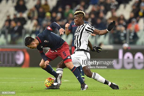 Paul Pogba of Juventus FC tackles Armando Izzo of Genoa CFC during the Serie A match between Juventus FC and Genoa CFC at Juventus Arena on February...