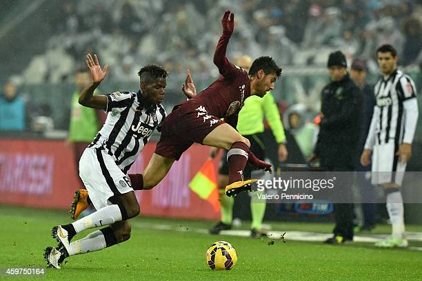 Paul Pogba of Juventus FC tackles Marco Benassi of Torino FC during the Serie A match between Juventus FC and Torino FC at Juventus Arena on November...