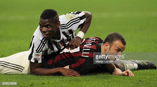 Paul Pogba of Juventus FC tangles with Luca Antonelli of AC Milan during the Serie A match between AC Milan and Juventus FC at Stadio Giuseppe Meazza...