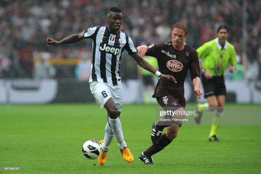 <a gi-track='captionPersonalityLinkClicked' href=/galleries/search?phrase=Paul+Pogba&family=editorial&specificpeople=5805302 ng-click='$event.stopPropagation()'>Paul Pogba</a> (L) of Juventus in action against Alessandro Gazzi of Torino FC during the Serie A match between Torino FC and Juventus at Stadio Olimpico di Torino on April 28, 2013 in Turin, Italy.