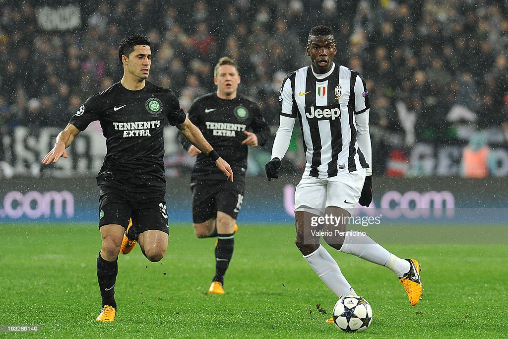 Paul Pogba (R) of Juventus in action against Beram Kayal of Celtic during the UEFA Champions League round of 16 second leg match between Juventus and Celtic at Juventus Arena on March 6, 2013 in Turin, Italy.