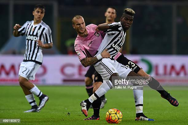 Paul Pogba of Juventus is challenged by Aljaz Struna of Palermo during the Serie A match between US Citta di Palermo and Juventus FC at Stadio Renzo...