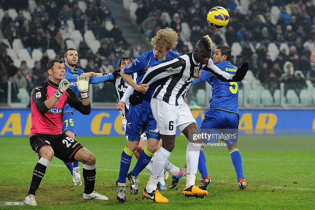 <a gi-track='captionPersonalityLinkClicked' href=/galleries/search?phrase=Paul+Pogba&family=editorial&specificpeople=5805302 ng-click='$event.stopPropagation()'>Paul Pogba</a> (R) of Juventus is challenged by Dusan Basta of Udinese Calcio during the Serie A match between Juventus and Udinese Calcio at Juventus Arena on January 19, 2013 in Turin, Italy.
