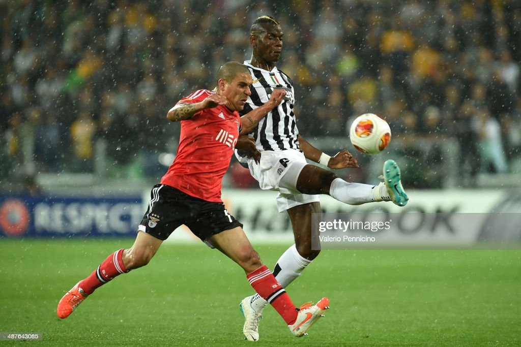 <a gi-track='captionPersonalityLinkClicked' href=/galleries/search?phrase=Paul+Pogba&family=editorial&specificpeople=5805302 ng-click='$event.stopPropagation()'>Paul Pogba</a> (R) of Juventus is challenged by <a gi-track='captionPersonalityLinkClicked' href=/galleries/search?phrase=Maxi+Pereira&family=editorial&specificpeople=4500885 ng-click='$event.stopPropagation()'>Maxi Pereira</a> of SL Benfica during the UEFA Europa League semi-final second leg match between Juventus and SL Benfica at Juventus Arena on May 1, 2014 in Turin, Italy.