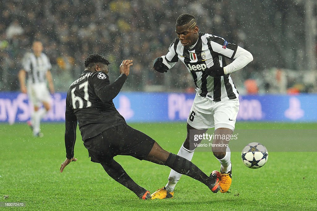 Paul Pogba (R) of Juventus is tackled by Victor Wanyama of Celtic during the UEFA Champions League round of 16 second leg match between Juventus and Celtic at Juventus Arena on March 6, 2013 in Turin, Italy.