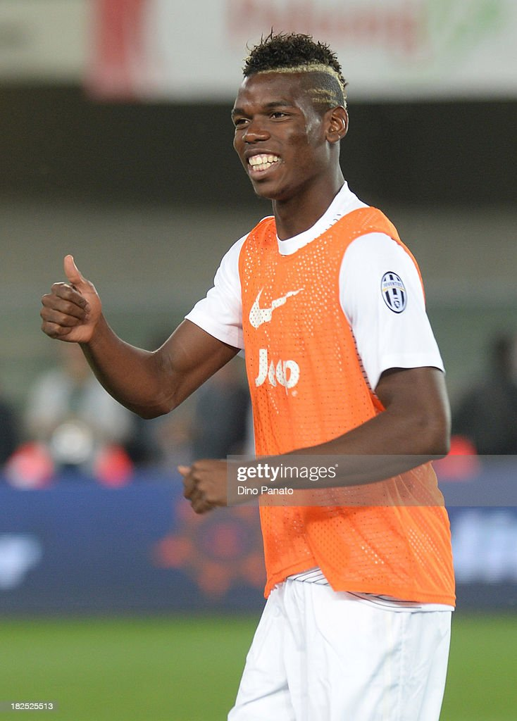 <a gi-track='captionPersonalityLinkClicked' href=/galleries/search?phrase=Paul+Pogba&family=editorial&specificpeople=5805302 ng-click='$event.stopPropagation()'>Paul Pogba</a> of Juventus looks on during warms up before the Serie A match between AC Chievo Verona and Juventus at Stadio Marc'Antonio Bentegodi on September 25, 2013 in Verona, Italy.