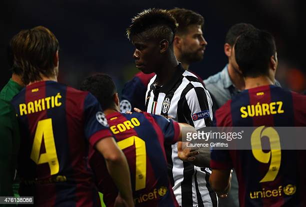 Paul Pogba of Juventus shakes hands with Pedro Rodriguez of Barcelona as he walks to collect his runners up medal after the UEFA Champions League...