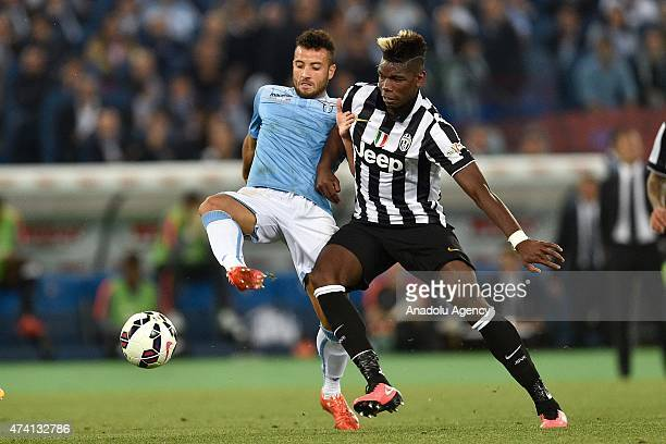 Paul Pogba of Juventus vies with Danilo Cataldi of Lazio during the TIM Cup final match between SS Lazio and Juventus FC at Olimpico Stadium on May...