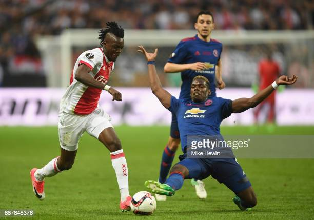 Paul Pogba of Manchester United and Bertrand Traore of Ajax in action during the UEFA Europa League Final between Ajax and Manchester United at...