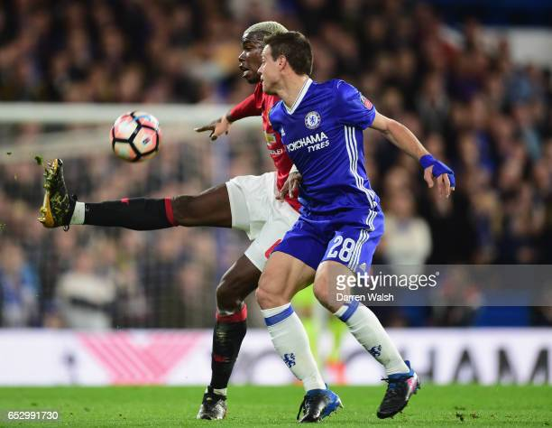Paul Pogba of Manchester United and Cesar Azpilicueta of Chelsea battle for the ball during The Emirates FA Cup QuarterFinal match between Chelsea...