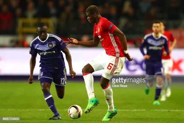Paul Pogba of Manchester United and Dennis Appiah of RSC Anderlecht in action during the UEFA Europa League quarter final first leg match between RSC...