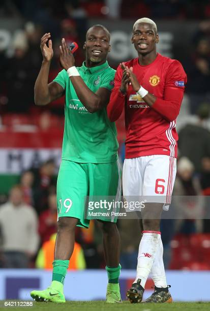 Paul Pogba of Manchester United and Florentin Pogba of AS SaintEtienne walk off after the UEFA Europa League Round of 32 first leg match between...