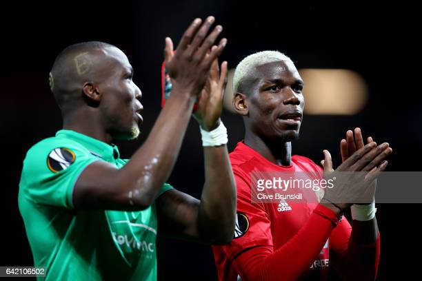 Paul Pogba of Manchester United and Florentin Pogba of Saint Ettienne applaud supporters during the UEFA Europa League Round of 32 first leg match...