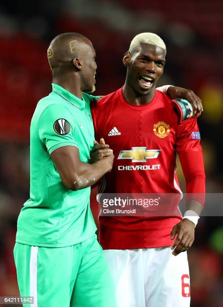 Paul Pogba of Manchester United and Florentin Pogba of Saint Ettienne speak during the UEFA Europa League Round of 32 first leg match between...